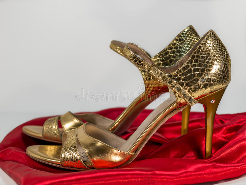 Pair of gold tango shoes - beautiful dance from Argentina stock photography