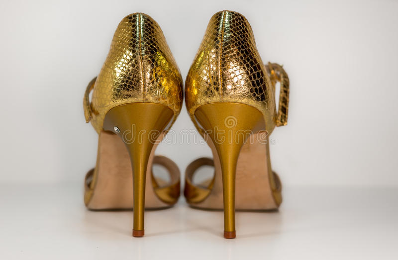 Pair of gold tango shoes - beautiful dance from Argentina royalty free stock images