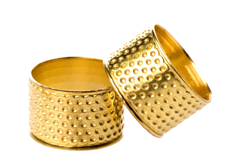 Download Pair of gold thimbles stock photo. Image of tools, metal - 6061468