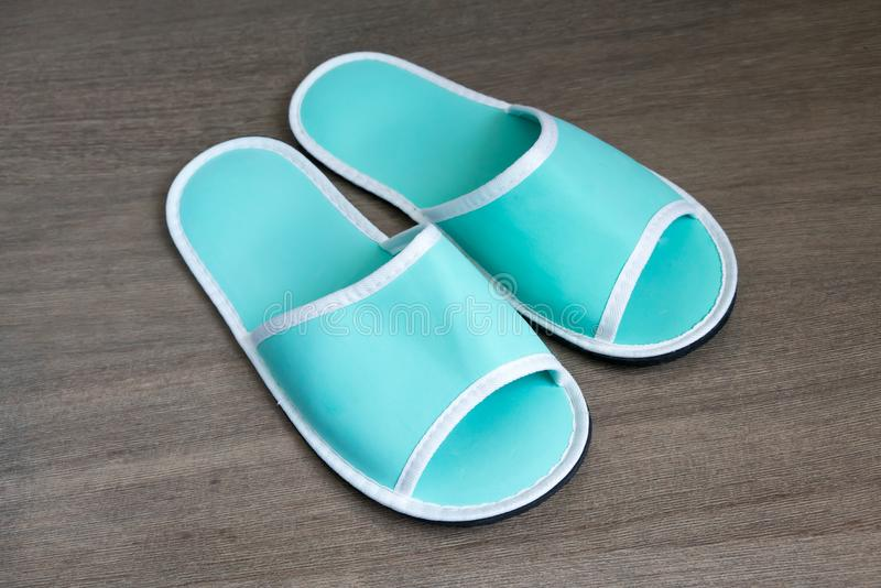 A pair of green disposable slippers with soft foam texture for i stock image