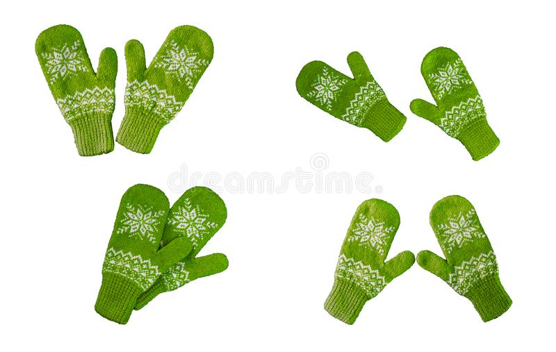 Pair of green knitted mittens with christmas pattern isolated on royalty free stock photo