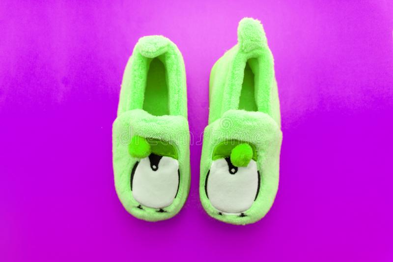 Pair of green textile slippers isolated over white stock photography