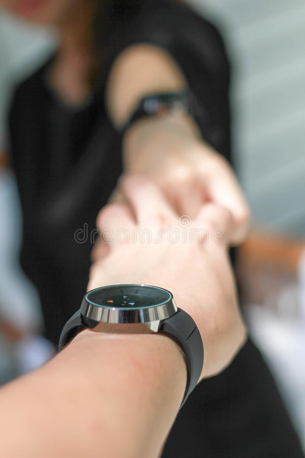 The Pair Of Hands Holding Each Other And The Couple Watch Stock ...