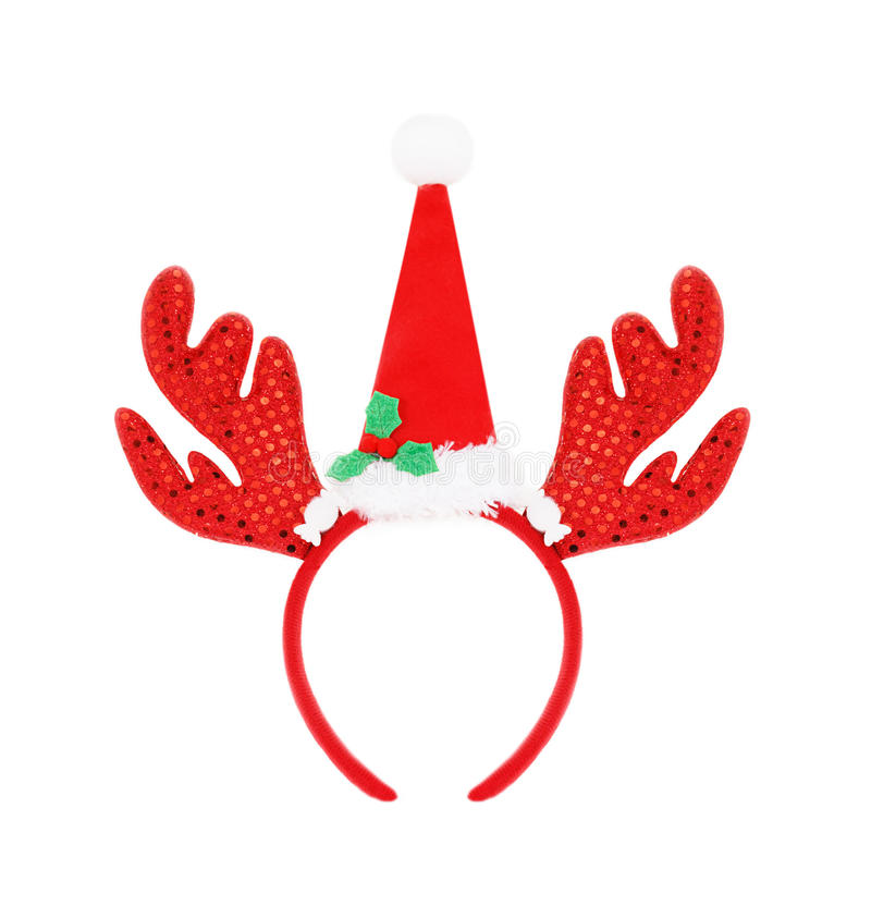 Pair of headband reindeer horns and santa hat isolated on white. Background royalty free stock image