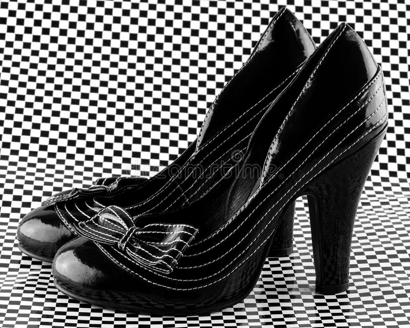 Pair of high heeled shoes stock photography