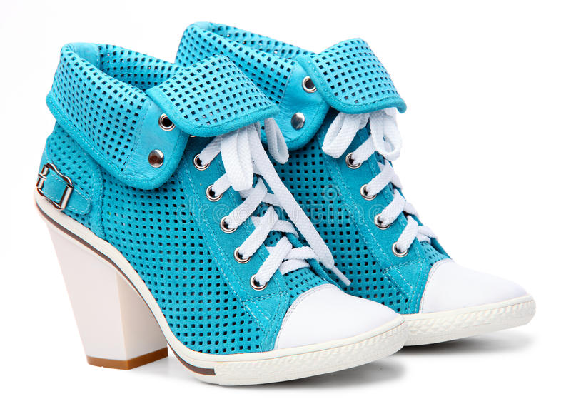 Pair of high-heeled turquoise female shoes royalty free stock photos