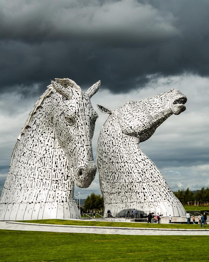 Pair of high modern buildings of horses under a cloudy sky in Falkirk in the United Kingdom. FALKIRK, UNITED KINGDOM - Oct 21, 2018: A pair of high modern royalty free stock image