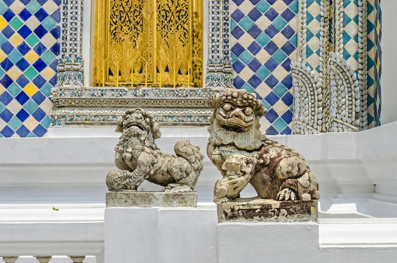 Chinese guardian lions at the entrance of one of the buildings within the Grand Palace in Bangkok, Thailand. Pair of highly stylized Chinese or Imperial guardian stock photos
