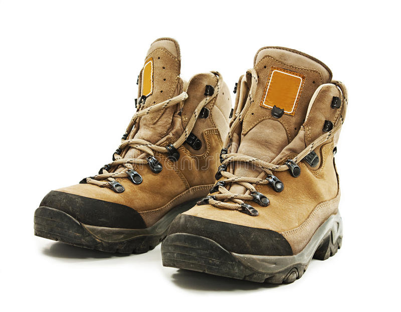 A pair of hiking boots. Isolated on white background stock image