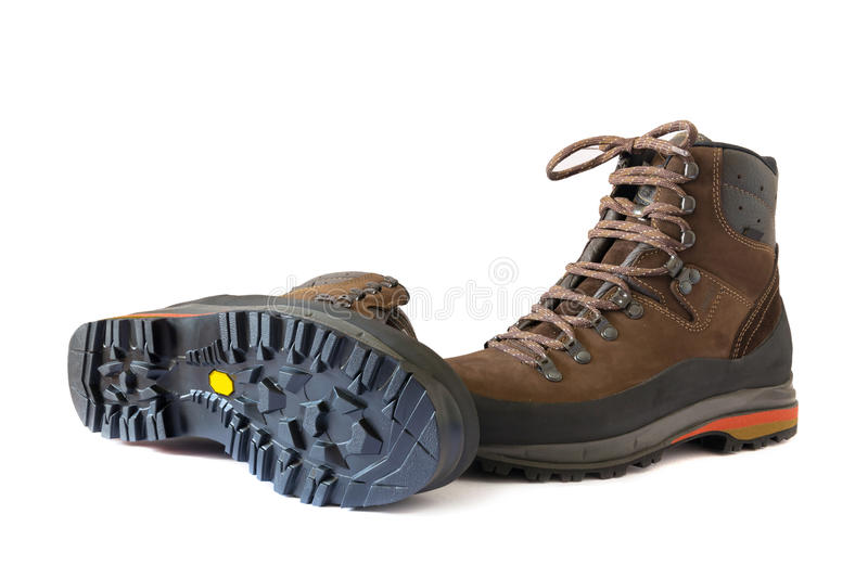 Pair of hiking boots. On a white paper stock photography