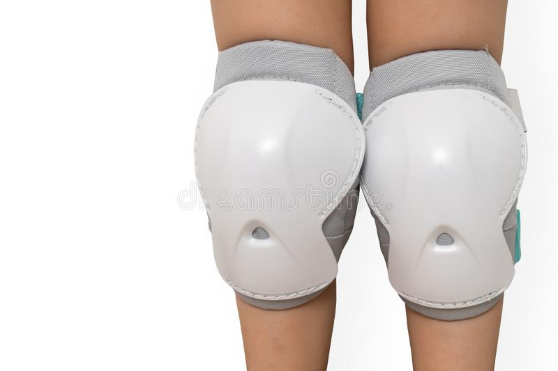 Pair of knee pads wearing on legs of child. Protectors for knees royalty free stock image