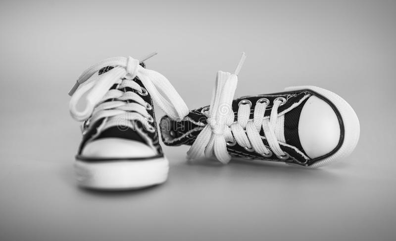Pair of Laced-up Black Low-top Sneakers stock photos