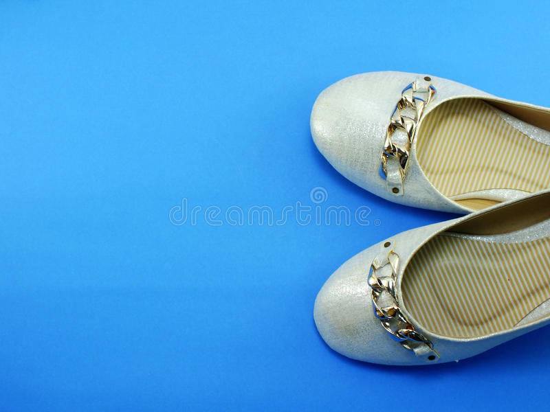 Pair ladies flat shoes. Ballerina ladies shoes on blue background stock images