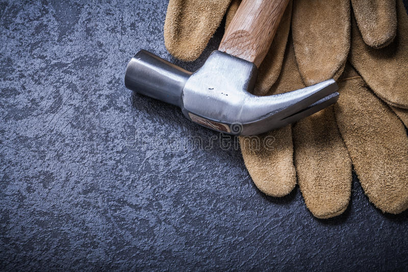 Pair of leather brown working gloves claw hammer. Construction concept royalty free stock photography
