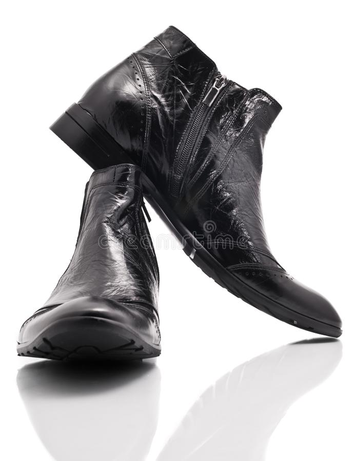 Pair of leather mens boots on white stock photo