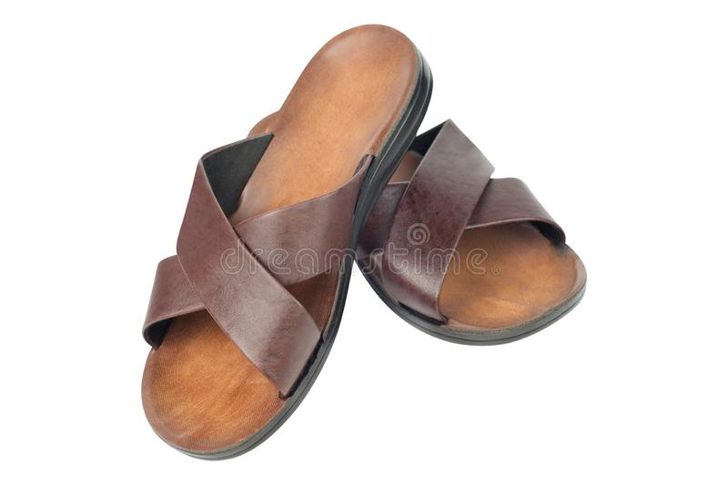 Pair of lightweight slippers for beach beside sea on vacation or domestic with two brown leather strips and plastic or rubber sole royalty free stock image