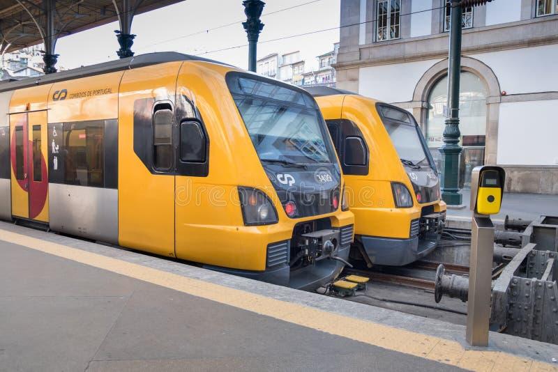 Pair of local yellow trains at Sao Bento station, Porto, Portugal stock photos