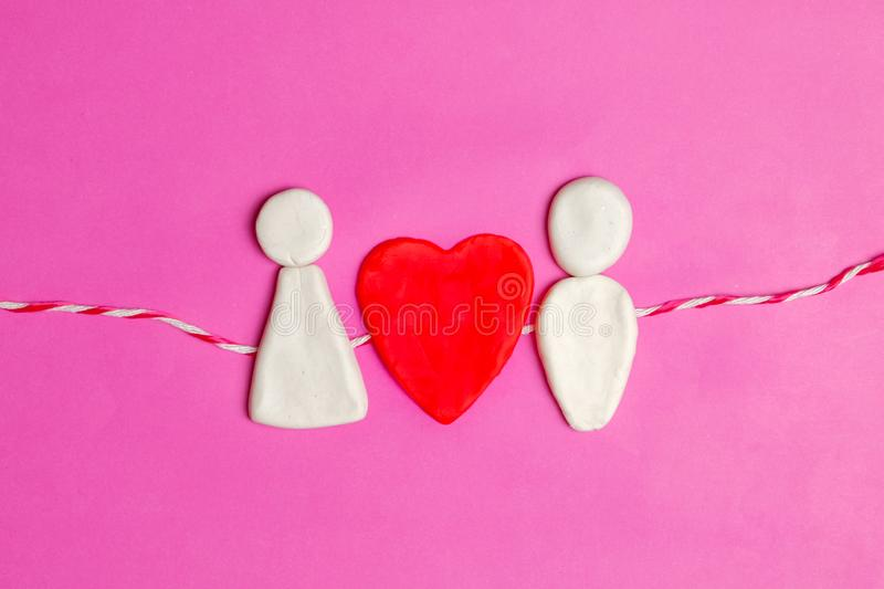 Pair of love, Valentines day, big red hearts and cute couple cartoon in love together on pink background stock photography