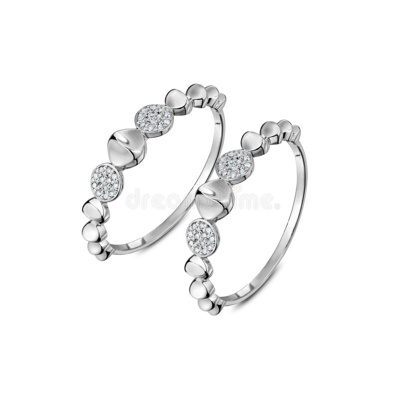 A pair of luxury white gold rings with diamonds stock photo