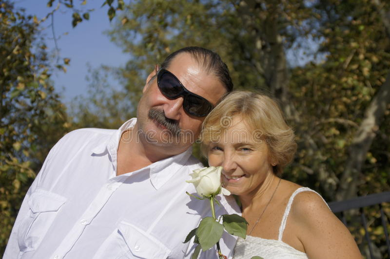 A pair of mature age. A pair of mature vozrasta.Silver wedding royalty free stock images