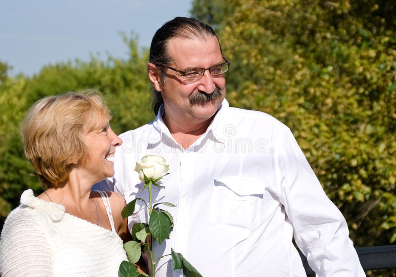 A pair of mature age. A pair of mature vozrasta.Silver wedding stock photography