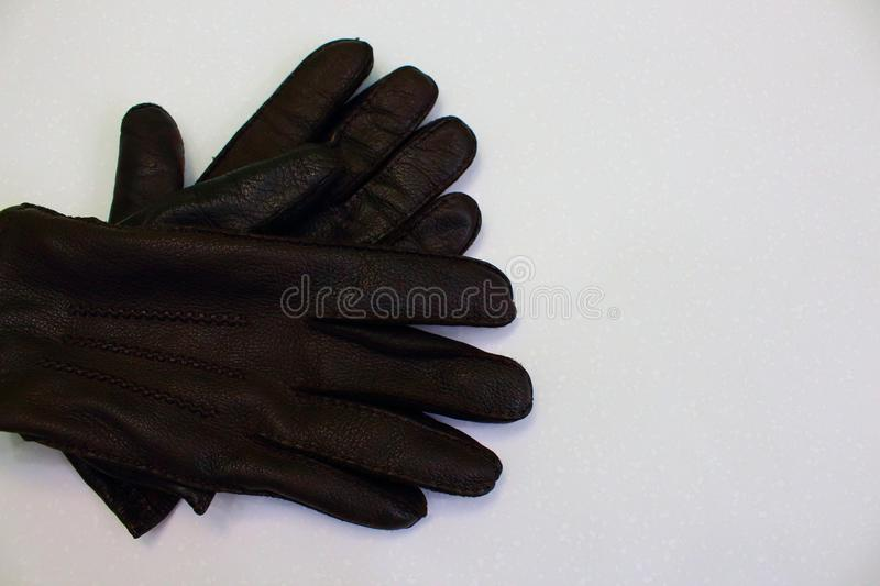 Pair of men leather brown gloves isolated on white background as season warm clothes accessories background. Clothes fot autumn and winter. Men fashion royalty free stock photography