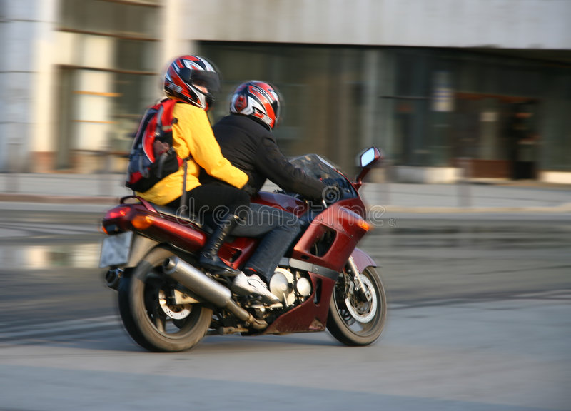 Pair on a motorcycle. royalty free stock photo