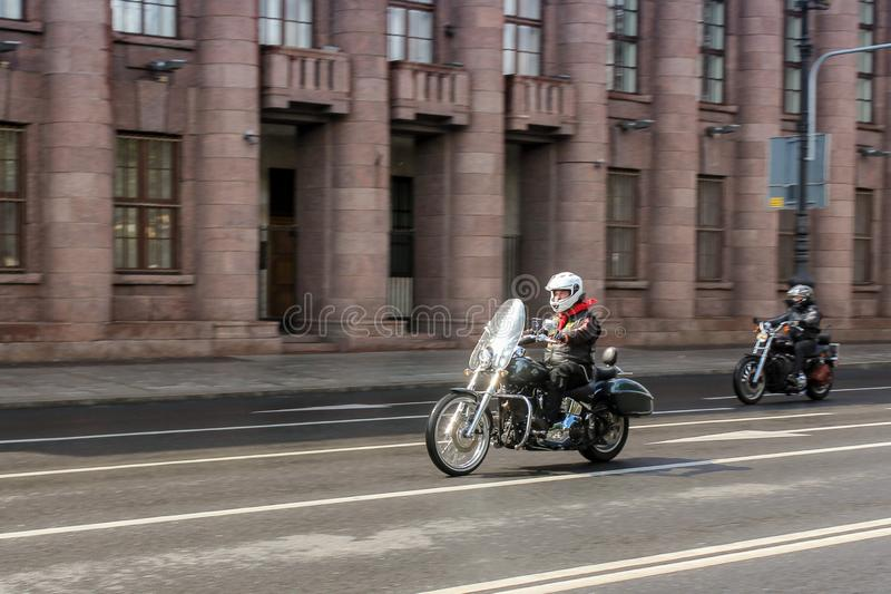 A pair of motorcyclists in motion stock photos