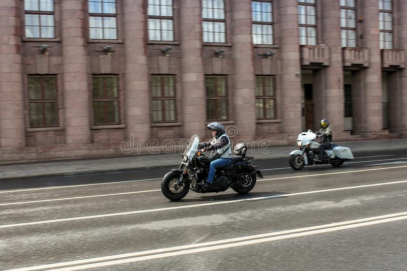 A pair of motorcyclists at speed in motion stock image