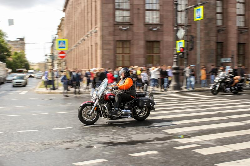 A pair of motorcyclists at speed in motion stock photography