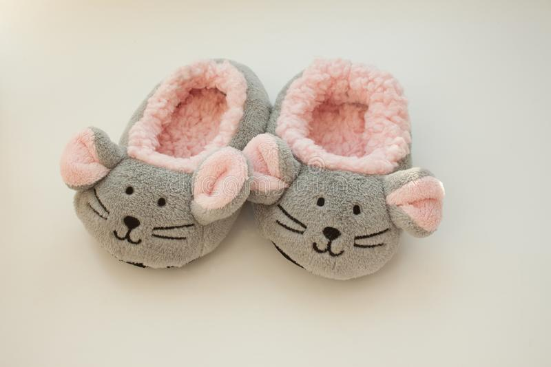 Pair of mouse slippers on white background. Children`s home shoes royalty free stock images