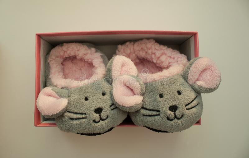 Pair of mouse slippers on white background. Children`s home shoes stock images