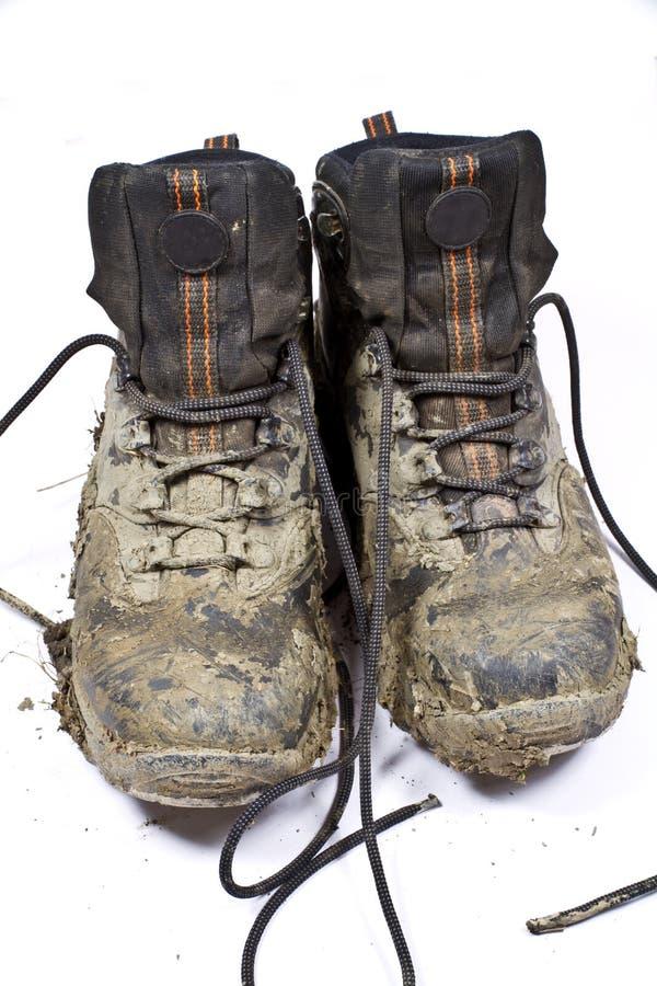 Pair muddy walking boots royalty free stock photography
