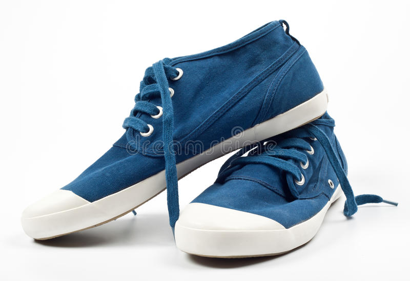 A pair of new blue shoes stock image