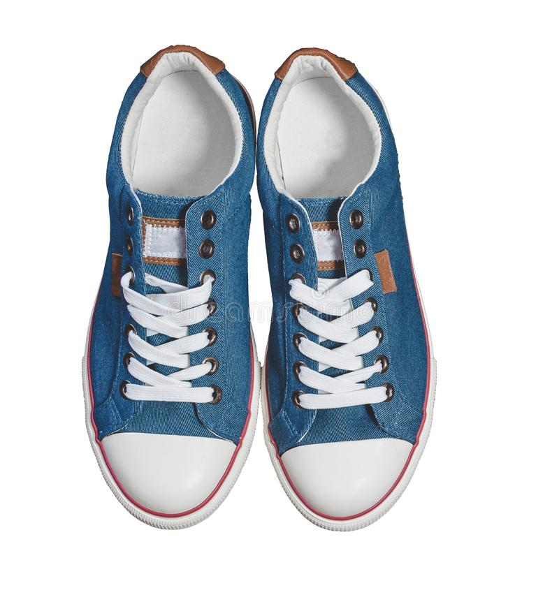 Pair of new blue sneakers isolated - view from above on white background. stock photography