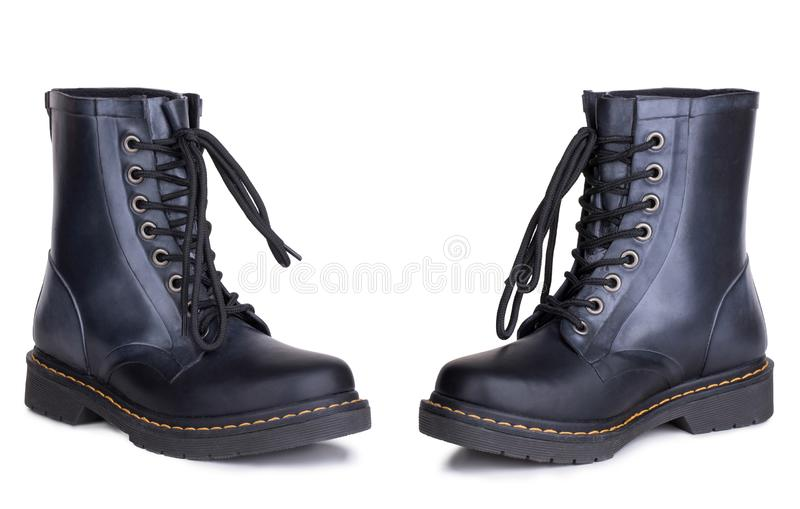 A pair of new shiny polished black leather dr. Marten boots shoes. Two isolated stock image