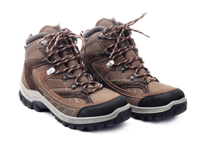 Pair of new hiking boots. Isolated on white background stock photography
