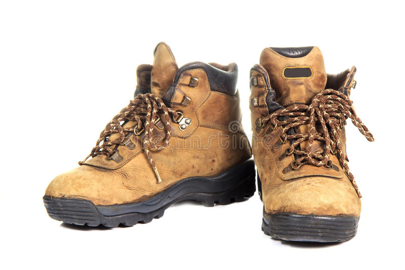 A pair of new hiking boots on white background. A pair of new hiking boots on white background royalty free stock photos