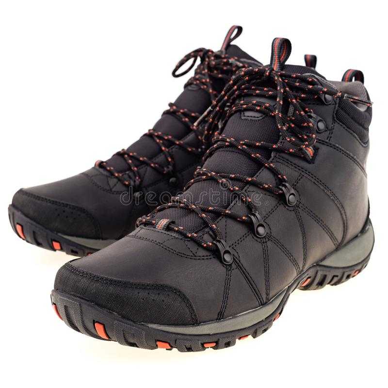 A pair of new hiking boots on white background. Isolated on whit. E background. Selective focus royalty free stock photos