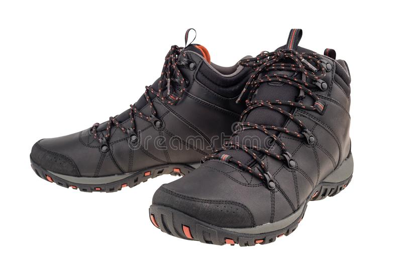A pair of new hiking boots on white background. Isolated on white background. Selective focus stock photos