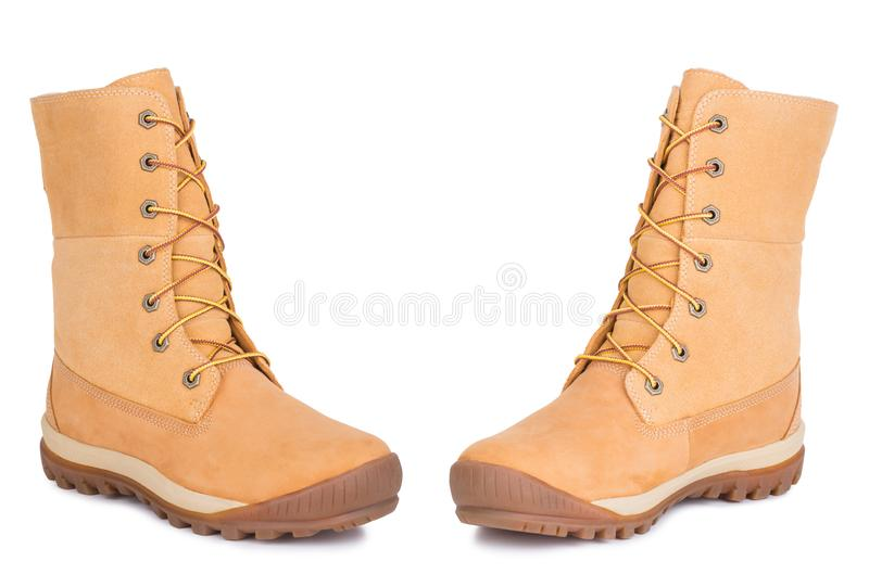 A pair of new yellow military leather dr. Marten Timberland boots shoes. Two isolated. A pair of new military woman female laced yellow sandy leather dr. Marten stock photos