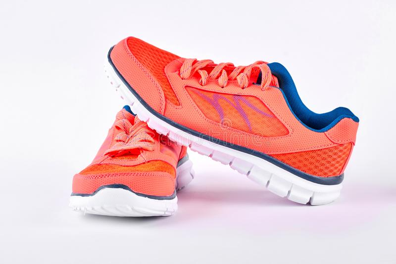 Pair of new modern sport shoes. Running shoes isolated on white background. Sport trainers for gym activity royalty free stock photos