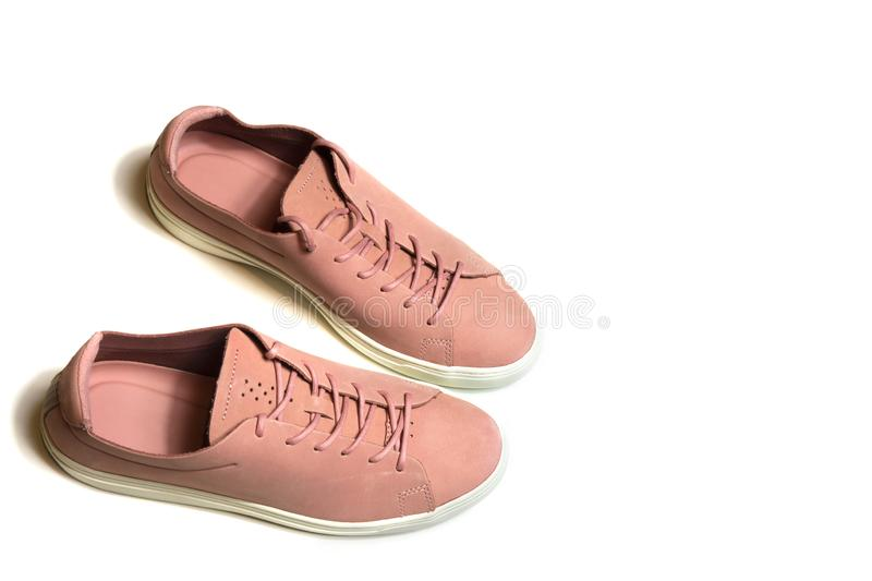 Pair of new pink sneakers on isolated white background royalty free stock photo