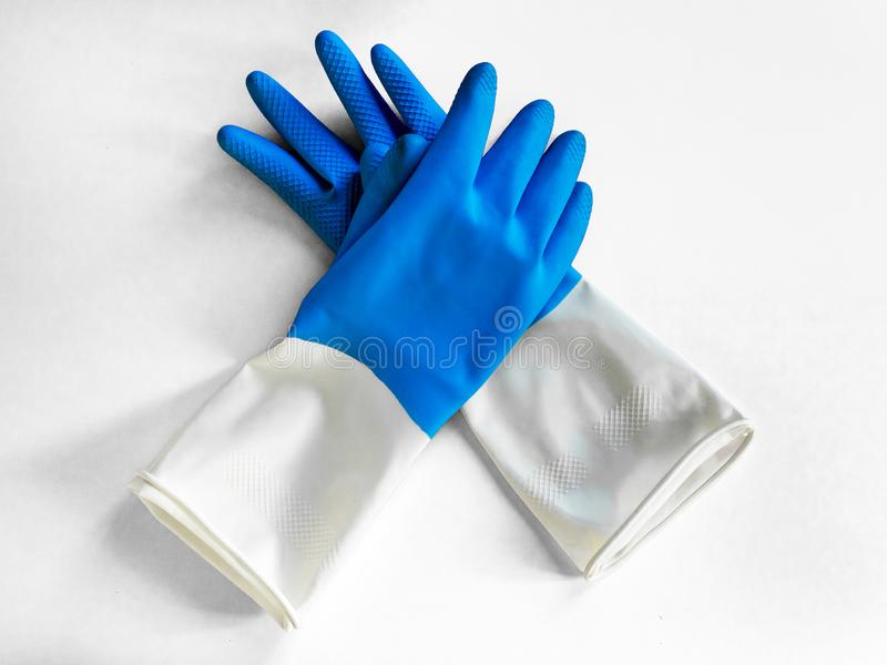 Pair of nitrile blue gloves isolated on white background. Closeup top view. housework concept. General or regular cleanup. Commercial cleaning company royalty free stock images