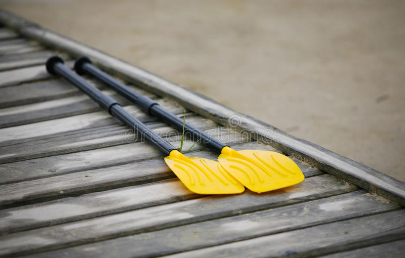 Pair oars on the pier. Pair oars on the wooden pier royalty free stock photos