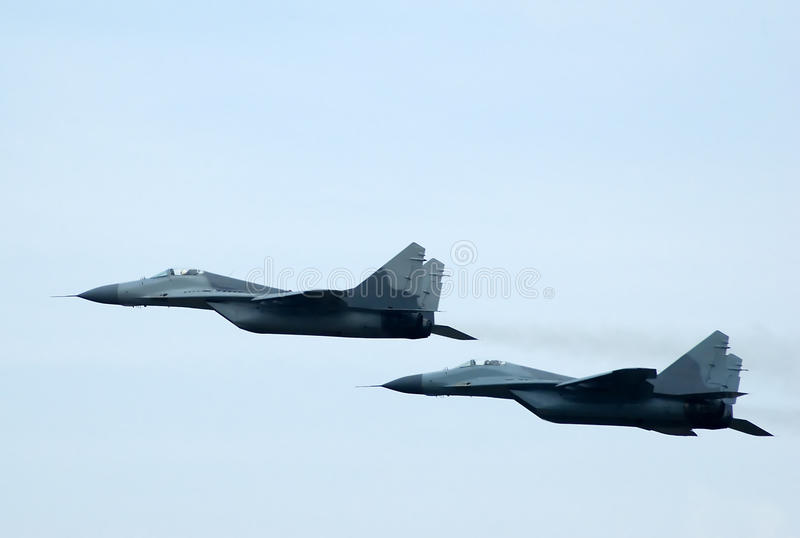Pair off MIG-29 FULCRUM. In assault stock photography