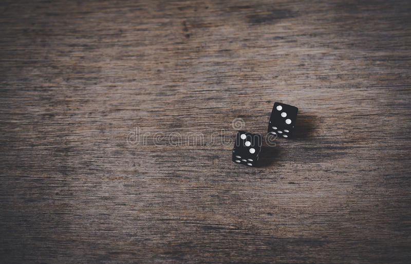 Pair of old black dices stock images