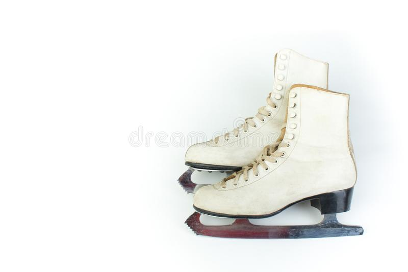 Pair of old Figure Ice Skates Isolated on White Background. Copy space for text. Top view. royalty free stock photography