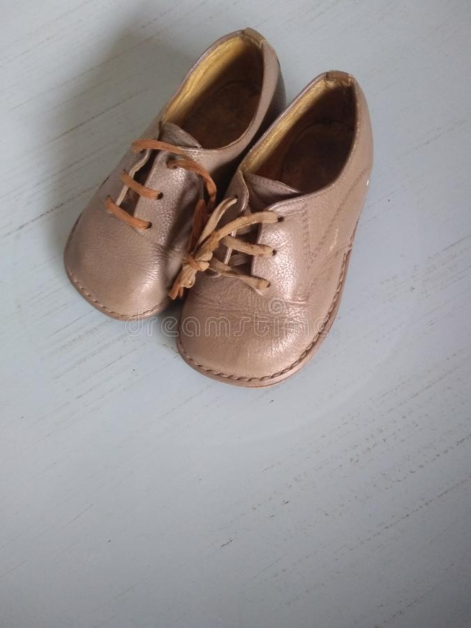 Pair of old hand made baby boy shoes stock photos