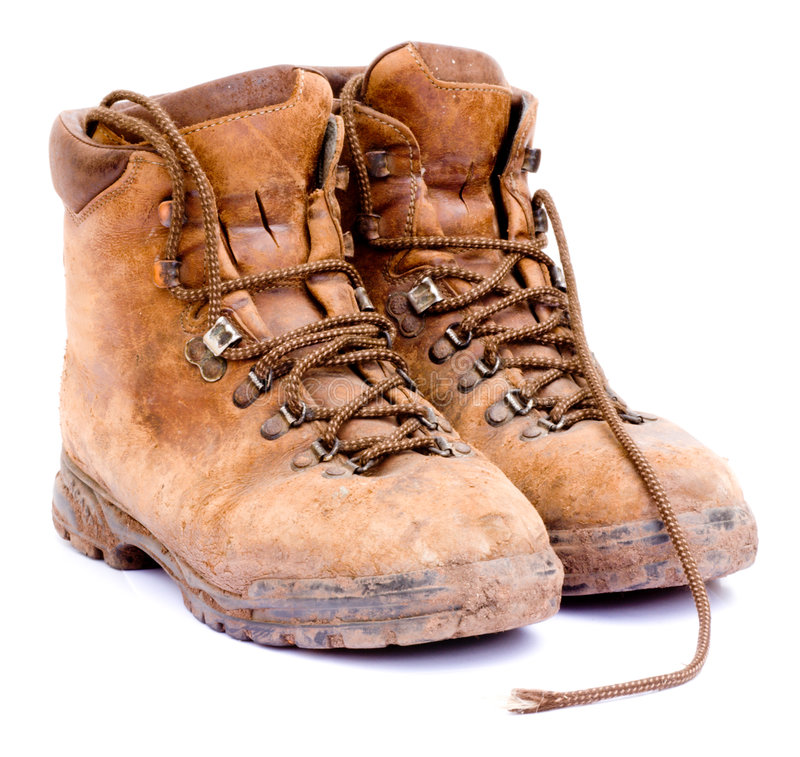 Pair of old worn walking boots. A pair of old worn walking boots isolated on a white background stock image